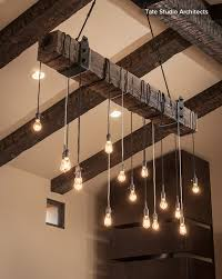 lighting on exposed beams love this clever way of creating overhead lighting with an exposed