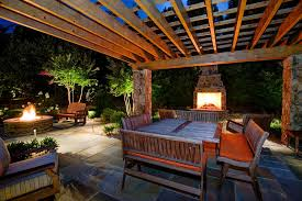 traditional space with outdoor fire pit u0026 outdoor cusions in mc