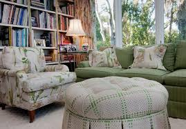 green patterned ottoman with white area rug living room