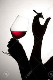 wine silhouette silhouette of woman drinking wine with cigarette stock photo