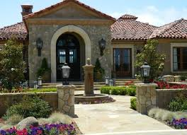 glamorous home design with round stone fountain and wrought iron