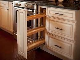 a slim pantry pullout adjacent to the stove provides additional