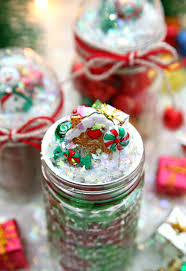 create these snow globe mason jars to hold holiday gifts