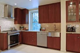 a guide to choosing kitchen cabinets curbed a contemporary kitchen with cherry wood cabinets