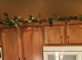 top of kitchen cabinet greenery this 6ft swag is filled with premium silk greenery