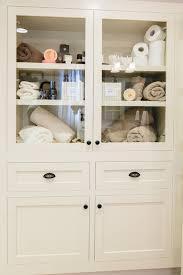 bathroom linen cabinet with glass doors built in linen cabinet transitional bathroom redbud