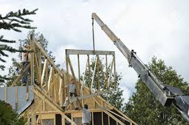 Frame A House by Quebec Canada July 4th Workers Framing A Roof Of A New House