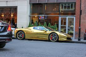 golden ferrari 458 taking a walk through knightsbridge london