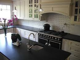 delightful modern kitchen cabinet design with black countertop and