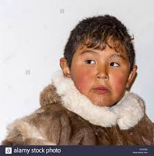 young inuit boy in traditional skin clothing grise fjord nunavut