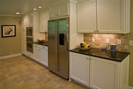kitchen backsplashes with white cabinets recessed lighting and