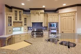 granite island kitchen kitchen with granite island carved woodwork stock photo
