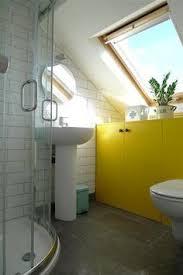 Small Attic Bathroom Sloped Ceiling by 15 Attics Turned Into Breathtaking Bathrooms Small Attic