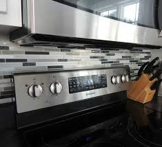 interior design elegant gas stove with peel and stick backsplash