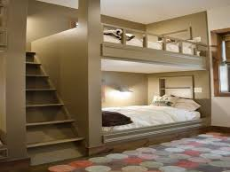 bedroom brown wooden loft bed with stairs and drawers also blue