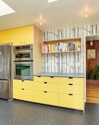 Kitchen Yellow Walls White Cabinets by Blue Floral Wallpaper White Cabinets Floating Shelves Green Island