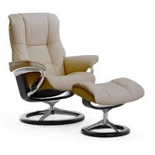 sit back and relax in the stella rocker recliner and ottoman with