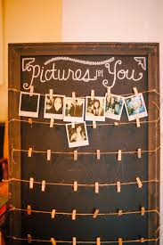 wedding wishes board polaroid at the sign in table for guests to take photos to