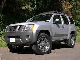 lifted nissan frontier revtek 2 u2033 front and 1 5 u2033 rear suspension lift for 05 14 xterra