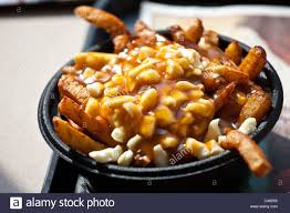 poutine cuisine poutine at la province restaurant in montreal canada stock