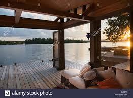 covered patio on a wooden deck on the water u0027s edge at sunset lake
