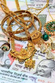 gold ornaments on indian currency stock photo picture and royalty