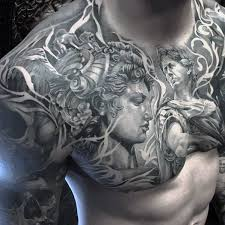 black and grey ancient sculpture on chest for
