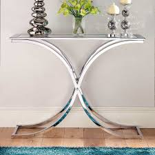 glass console table with nice flowers and unique table lamp and