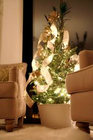 a small living tree in socal might be a better idea with a faux