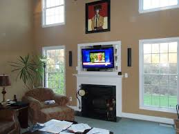 tv over gas fireplace design for small space family room