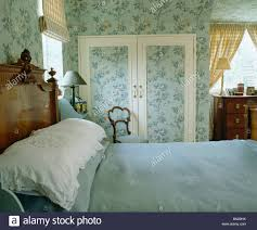 blue linen and white lace edged pillows on bed in country bedroom