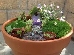 decorating miniature garden gnomes and fairies small garden