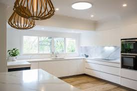 white handleless kitchens true handleless kitchens co uk using the white handleless kitchen as the main background colour you can easily introduce colour into either the cladding panels glass splash back or the