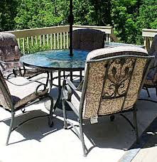 Outdoor Table Lazy Susan by Etched Glass Table With Lazy Susan Umbrella And Five Chairs Ebth