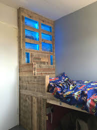 How To Make A Platform Bed Frame With Pallets by Raised Pallet Led Lit Kids Bed U2022 1001 Pallets