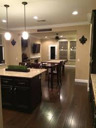 dark espresso cabinets with light tile floors and light speckled
