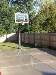 there is marks concrete slab court in his backyard next to pics