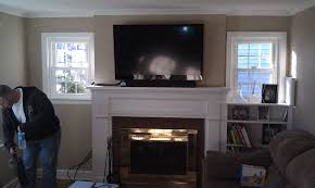 cool living room design with mounting a tv over a fireplace and