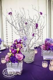 Purple Flowers Centerpieces by Purple Flowers Centerpieces Silver Wine Bottles Purple