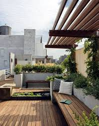 tiered planter box seating and decking rooftop garden