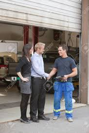 Garage Length by Full Length Of Mechanic Shaking Hands With Client Outside Garage
