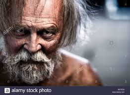 looking with grey hair rugged and crazy looking wrinkled older man with grey hair and