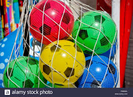 multicolored plastic pseudo football balls in net back on sale