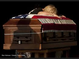 debbie tuttle pauses over the casket of her son and fallen soldier