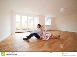 young couple room young couple sitting in empty room of dream house stock photo