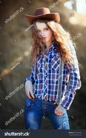 young beautiful cowboy hat jeans stock photo 451852402