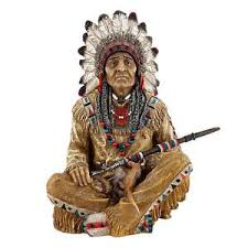 american indian chief sitting cross legged west peace pipe