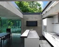 glass roof house bespoke sliding over roof rooflight for concrete frame house building