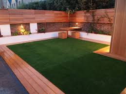 artificial grass and decking look great with good garden lighting