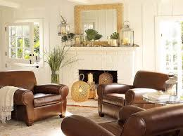 white brick fireplace connected by brown leather chairs on the rug